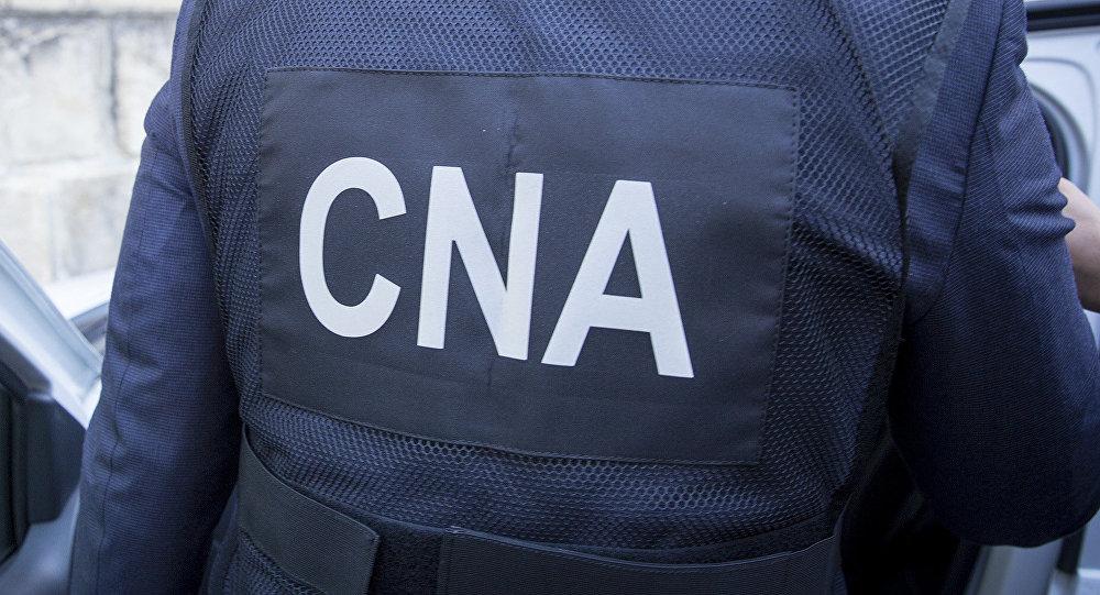 Doi făleșteni, reținuți de ofițerii CNA pentru mită în valoare de 17500 de euro